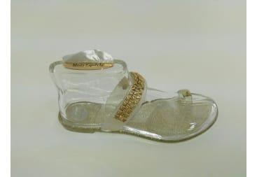 Sandalia transparente y purpurina dorada